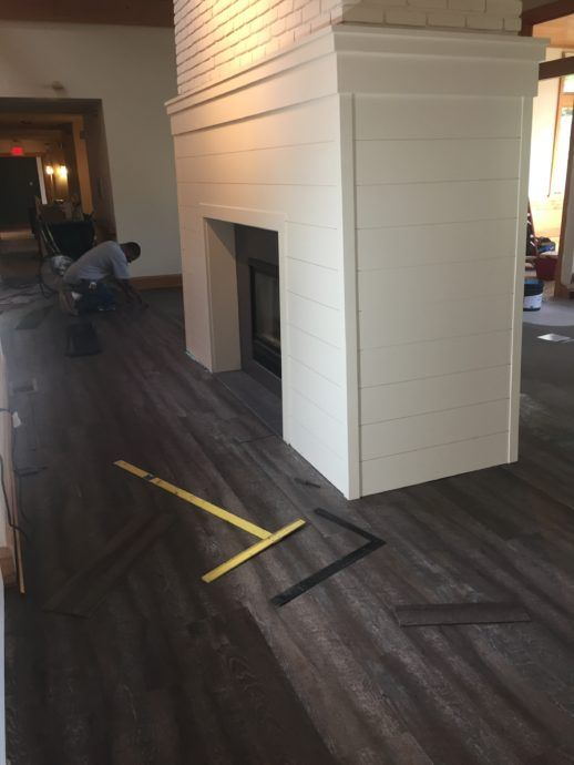 The flooring is being laid around the updated fireplace!